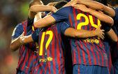 Group of FC Barcelona players celebrating goal — ストック写真