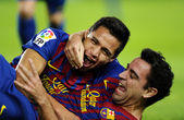 Alexis Sanchez(L) and Xavi Hernandez(R) of FC Barcelona — Stock Photo
