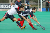 Gabriel Dabanch(L) of RC Polo vies with Sebastien Techy(R) of KHC Leuven — Stock Photo