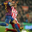 Stock Photo: Dani Alves(L) of FC Barcelonvies with Nacho Cases(R) of Sporting de Gijon