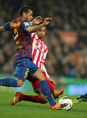 Dani Alves(L) of FC Barcelona vies with Nacho Cases(R) of Sporting de Gijon — Stock Photo