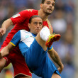 Sergio Garcia(F) of Espanyol vies with Alberto Botia(B) of Sporting Gijon — Stock Photo