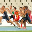 Competitors on start of 100m of Decathlon - Foto Stock