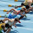 Competitors on start of 110m men hurdles — Stock Photo