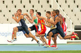 Competitors on start of 100m of Decathlon — Stock Photo