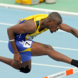 Tramaine Maloney of Barbados during 400m hurdles - Stock Photo