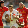 Постер, плакат: Stade Toulousain Luke Burgess R is tackled by USAP player Luke Charteris L