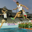 Alex Genest of Canada(L) and Jimenez Pentinel(R) of Spain in action on 3000m steeplechase Event — Stock Photo #19343647