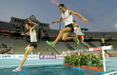 Alex Genest of Canada(L) and Jimenez Pentinel(R) of Spain in action on 3000m steeplechase Event — Stock Photo
