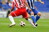 Soccer player legs in action — Stock Photo