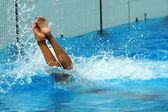 Swimmer launched into water — Stockfoto