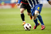 Soccer player legs in action — Stok fotoğraf