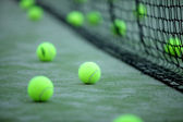 Tennis or paddle balls on synthetic grass — Stock Photo