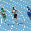 Stock Photo: Athletes running on track