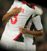 Soccer players hugging — Stock Photo