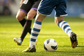 Two soccer players vie — Stock Photo