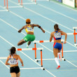 Stock Photo: Competitors of 400m hurdles