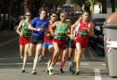 Barcelona street crowded of athletes running — Stock Photo