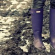 Stock Photo: Boots in mud