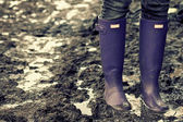Boots in the mud — Stock Photo