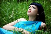 Beautiful girl in grass — Stock Photo