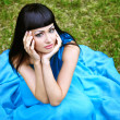 Stock Photo: Attractive lady in blue dress on grass