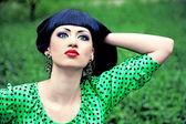 Beautiful girl in green dress outdoors — Stock Photo