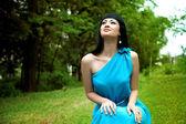 Happy lady in dress in summer garden — Stock Photo
