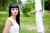 Beautiful woman in summer garden — Stock Photo