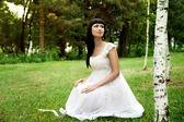 Beautiful woman in white dress — Stock Photo