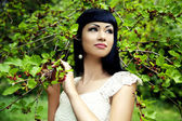 Beautiful woman with mulberry — Stock Photo