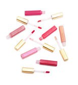 Set of lip glosses with different colours isolated on white — Stock Photo
