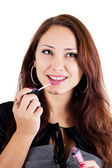 Portrait of smilling woman with lip gloss — Stock Photo