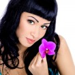 Beautiful woman with orchid flower — Foto de Stock