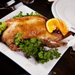 Roast duck with orange and parsley — Stock Photo #22815002