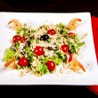 Salad with shrimp, tomatos and olives - Stock Photo