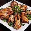 Cooked quail with parsley - Stock Photo