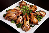 Cooked quail with parsley — Stock Photo