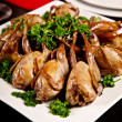 Fried quail with parsley on plate  — Stock Photo