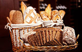 Variety of baked bread in baskets — Stock Photo