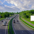 Billboards on the highway with lots of cars — Stock Photo