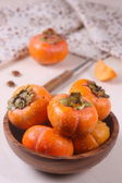 Persimmon on the table — Stockfoto