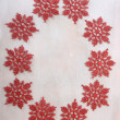 Christmas decoration with red snowflakes over wooden background — Stock Photo