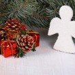 Christmas composition of spruce branches and white angel — Stock Photo