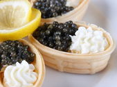 Canapes with cream cheese and caviar. — Stock Photo