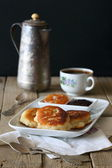 Pancakes with jam and a cup of coffee — Stock Photo