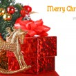 Composition with Christmas tree, gift box and toy horse — Stock Photo