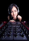 Wide angle female DJ on the decks — Stock Photo