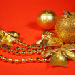 Golden Christmas ornaments — Stock Photo #14832115