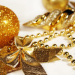 Golden Christmas ornaments — Stock Photo #14832217